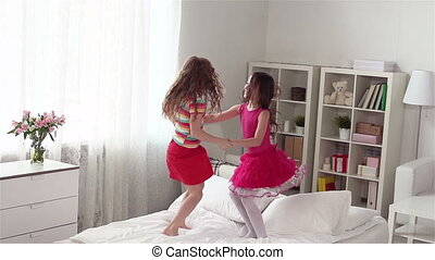 Jumpy Bed - Slow-mo of cute little girls jumping on the bed