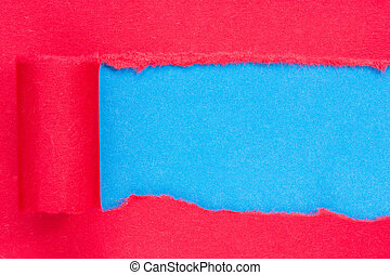 Red paper torn to reveal blue panel ideal for copy space
