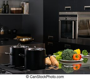 Fresh vegetables and pots on a modern kitchen