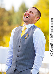 Handsome Grrom Wedding Day - A handsome groom looks happy on...