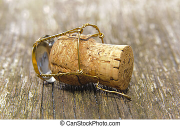 champagne cork on wooden table
