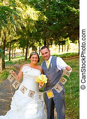 Bride Groom Thank You Banner - A bride and groom hold a...