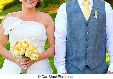 Headless Bride and Groom - A bride and groom are...