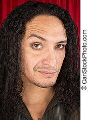 Skeptical Latino Man - Close up of skeptical Latino man with...