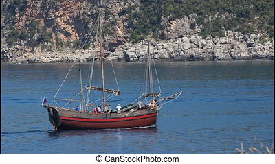 Old sailing ship, pirates at sea