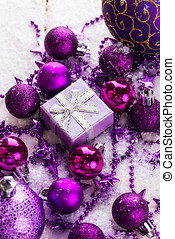 Christmas background with purple christmas toys over wooden...