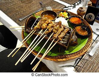 Indonesian grilled Satay - Sticks of Indonesian grilled...