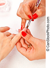 Manicurist - Closeup picture of a manicurists hands making...