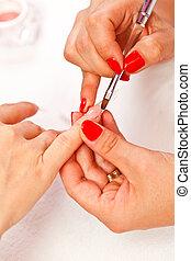 Manicurist - Closeup picture of a manicurist's hands making...