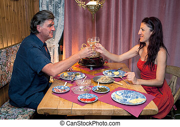 Couple Having Romantic Raclette Dinner. - Romantic couple...