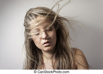 Young woman with long beautiful healthy blond hair - Young...