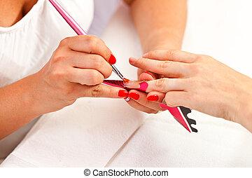 At manicurist