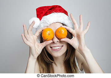 Funny christmas girl - Funny girl in a christmas hat with...