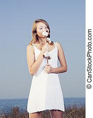 Smelling a cotton plant