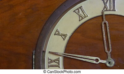 Antique wooden clock, almost twelve - Close up view of a...