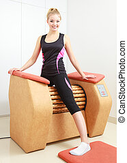 Girl on relax massage equipment spa
