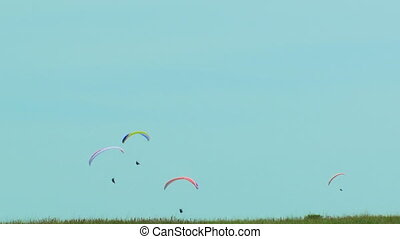 Paragliding in the sky - People paragliding high in the sky...