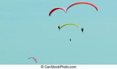 Extreme sport - Paragliding high in the sky