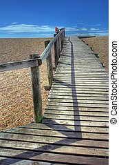 Seaside boardwalk - Wooden boardwalk over Chesil Beach,...