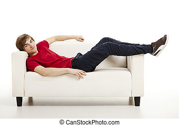 Time to relax - Handsome young man at home lying on the...