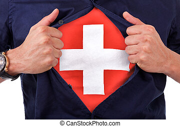 Young sport fan opening his shirt and showing the flag his country switzerland, swiss flag