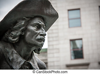 Statue in Montreal - State with a hat in a square in old...