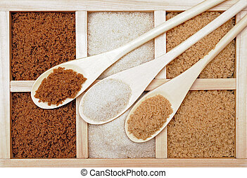Three kinds of sugar: dark brown, white, and brown