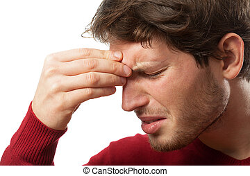 Sinus pain - Man holding his nose because of a sinus pain