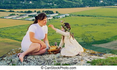 Family picnic - Mother and daughter on an alpine picnic
