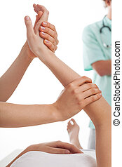 Physiotherapy clinic - Physiotherapists treating a patient...