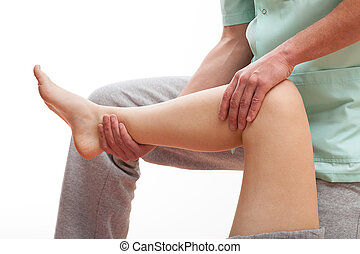 Leg muscles recovery - Physiotherapist massaging the leg's...
