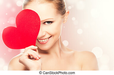face of a beautiful young woman with red heart symbol of...