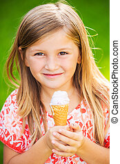 Cute little girl eating ice cream - Happy cute little girl...