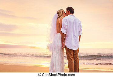 Bride and Groom, Enjoying Amazing Sunset on a Beautiful...
