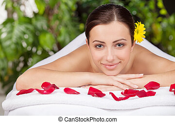Spa girl. Attractive young woman looking at camera and...