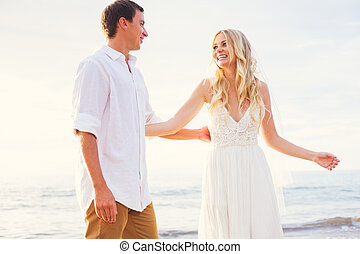Bride and Groom Watching Sunset on Beautiful Tropical Beach, Romantic Married Couple