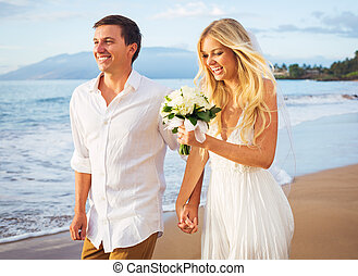Bride and Groom Walking on Beautiful Tropical Beach at...