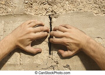 two hands - hands apart crack wall