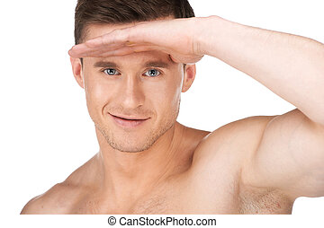 Portrait of young sexy nude man. Making a look like searching for something