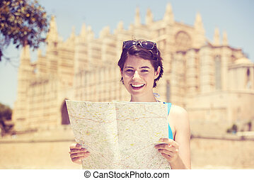 Woman sightseeing with a map