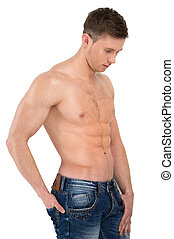 Sexy naked male model standing in jeans only. Holding hand...