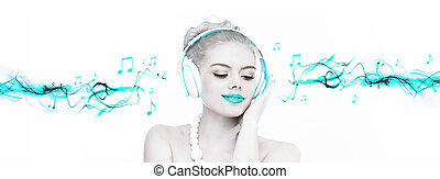 Beautiful woman enjoying her music listening to her...