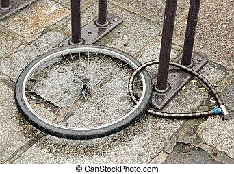 Stolen bike, wheel and padlocks left on the spot