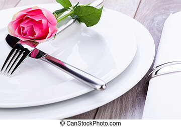 Table setting with a single pink rose - Romantic formal...