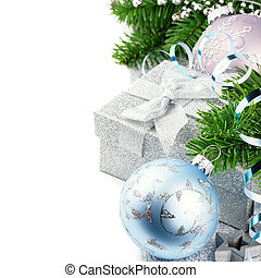 Christmas gift and festive ornaments isolated over white