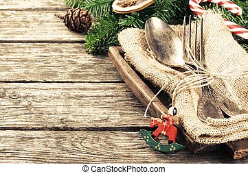 Christmas table setting in retro style on wooden table