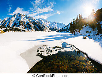 Big Almaty lake on december Water, ice, mountains and snow