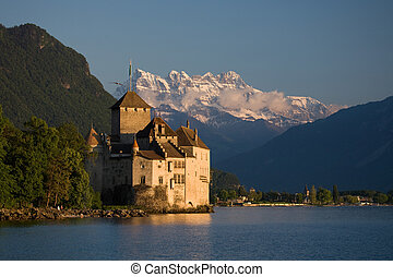 Chillon Castle on Lake Geneva with the Dents du Midi in the...