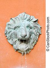 fountain lion on orange wall