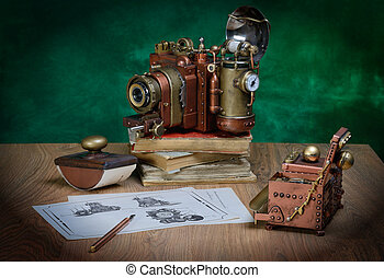 Camera steampunk - Photo camera and drawing on a wooden...